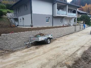 Izkop in postavitev podpornega zidu